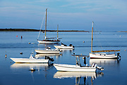 Anchored boats at sunset, Chatham, Cape Cod, Massachusetts, USA.
