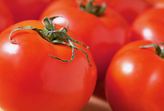 A group of Beefsteak tomatoes on a table