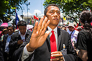 08 MAY 2013 - BANGKOK, THAILAND: WORACHAI HAYMA, a Pheu Thai (ruling party) member of the Thai Parliament, greets Red Shirt supporters in front of the parliament building in Bangkok during a Red Shirt protest. A splinter group of the Red Shirts, Thai supporters of exiled Prime Minister Thaksin Shinawatra, have besieged the Thai Constitutional Court for the last three weeks calling for the resignation of the justices, who have indicated they might oppose a proposed constitutional reform which would grant amnesty to people convicted of political crimes since 2007. This would probably include Thaksin. The justices have refused to step down. Wednesday the protesters moved their protest to the Thai Parliament, which is largely powerless to intervene.   PHOTO BY JACK KURTZ
