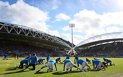 Huddersfield Town players warm up ahead of the Premier League match at the John Smith's Stadium, Huddersfield.