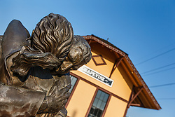 The Homecoming sculpture by Michael Pavlosky depicting returning soldier, Cotton Belt Railroad Depot, Grapevine, Texas USA