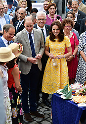 The Duke and Duchess of Cambridge tour a traditional German market in the central square of Heidelberg, Germany.
