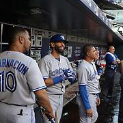 Jose Bautista, Toronto Blue Jays, with team mate Edwin Encarnacion, (left), in the dugout preparing to bat during the New York Mets Vs Toronto Blue Jays MLB regular season baseball game at Citi Field, Queens, New York. USA. 16th June 2015. Photo Tim Clayton