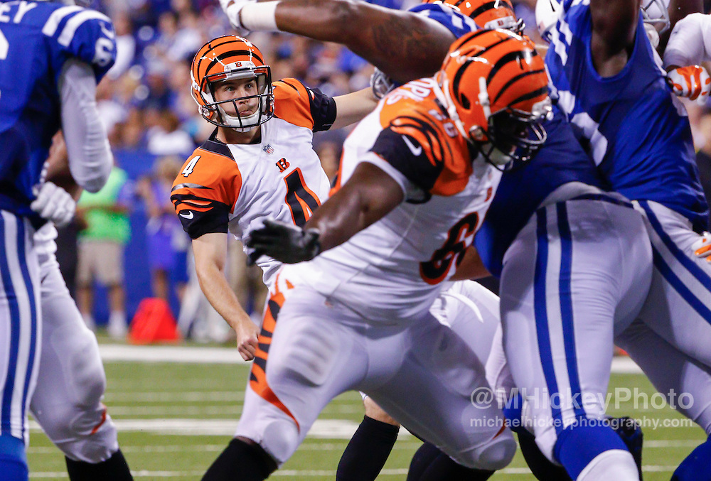 INDIANAPOLIS, IN - SEPTEMBER 3: Tom Obarski #4 of the Cincinnati Bengals watches his kick during the game against the Indianapolis Colts at Lucas Oil Stadium on September 3, 2015 in Indianapolis, Indiana. (Photo by Michael Hickey/Getty Images) *** Local Caption *** Tom Obarski