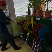 Girl working at the station moves a handle to change signals for the train arriving to the the Children's Railway station Huvosvolgy in the Buda Hills in Budapest, Hungary on November 13, 2014. ATTILA VOLGYI