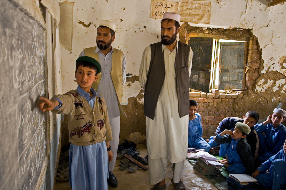 A lucky group of Afghani refugee boys in a refugee camp school in Pakistan.