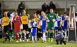 Bristol Rovers' captain Mark McChrystal and mascot lead players on to the pitch to face Gateshead - Photo mandatory by-line: Paul Knight/JMP - Mobile: 07966 386802 - 19/12/2014 - SPORT - Football - Bristol - The Memorial Stadium - Bristol Rovers v Gateshead - Vanarama Conference