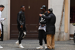 Mario Balotelli and his brother Enock are spotted in Milan