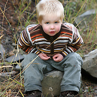 Liam Queneau, 2, takes a rest on his first hike looking for elk--or any interesting rock in the trail--in Yellowstone National Park.