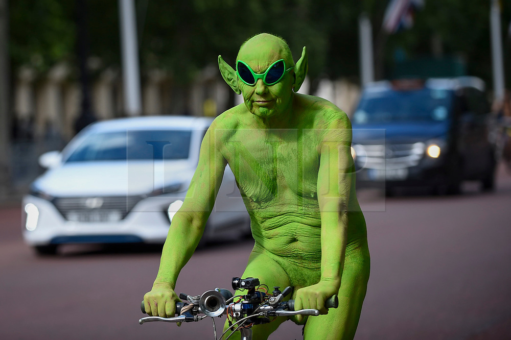 © Licensed to London News Pictures. 08/06/2019. LONDON, UK.  Participants ride down The Mall as they take part in The World Naked Bike Ride, an annual protest against oil dependency and car culture.  Photo credit: Stephen Chung/LNP