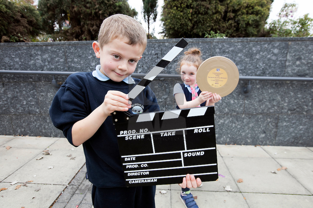 """Repro FRee: 03/11/2015 Pictured at the 11th FÍS Film Festival are students Daniel Gilrane and Orla Ryan from St. Hugh's NS, Dowra, who received the Award for 'Outstanding Achievement in Acting', for their film """"The Secret Life of Tess McGourty"""", at a ceremony in the Helix, Dublin, 3 November. Picture Andres Poveda"""