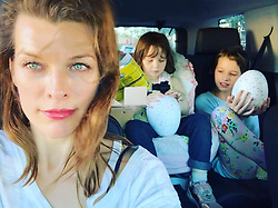 """Milla Jovovich releases a photo on Instagram with the following caption: """"Happy Sunday everyone! Having such a great weekend with the kids. @chrissbrenner played the \u201cUncle\u201d card and spoiled them with a post Christmas present, so there were extra smiles to go around!\ud83e\udd17 #ladiary"""". Photo Credit: Instagram *** No USA Distribution *** For Editorial Use Only *** Not to be Published in Books or Photo Books ***  Please note: Fees charged by the agency are for the agency's services only, and do not, nor are they intended to, convey to the user any ownership of Copyright or License in the material. The agency does not claim any ownership including but not limited to Copyright or License in the attached material. By publishing this material you expressly agree to indemnify and to hold the agency and its directors, shareholders and employees harmless from any loss, claims, damages, demands, expenses (including legal fees), or any causes of action or allegation against the agency arising out of or connected in any way with publication of the material."""