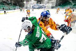 Nejc Brus of HK SZ Olimpija vs Alexander Gellert of Migros Supermercati Asiago during 3rd leg of ic hockey game between HK SZ Olimpija Ljubljana and Asiago Hockey in Final of Alps Hockey League 2020/21, on April 24, 2021 in Hala Tivoli, Ljubljana, Slovenia. Photo by Matic Klansek Velej / Sportida