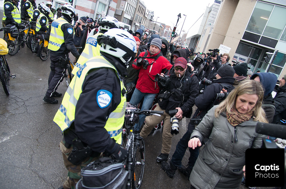 Journalists a pushed towards police after protesters make a move to march. The march was declared illegal by police as no route was provided to the authorities by protesters. March 15, 2015.
