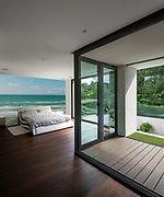 Bedroom in modern villa with private terrace. Nobody inside
