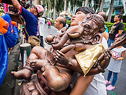 07 SEPTEMBER 2014 - BANGKOK, THAILAND: A man carries a statue of Ganesh to a waiting truck during the Ganesh Festival at Central World in Bangkok. Ganesh Chaturthi, also known as Vinayaka Chaturthi, is a Hindu festival dedicated to Lord Ganesh. It is a 10-day festival marking the birthday of Ganesh, who is widely worshiped for his auspicious beginnings. Ganesh is the patron of arts and sciences, the deity of intellect and wisdom -- identified by his elephant head. The holiday is celebrated for 10 days, in 2014, most Hindu temples will submerge their Ganesh shrines and deities on September 7.     PHOTO BY JACK KURTZ