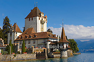 Oberhoffen Castle Lake Thun Bernese Oberland Switzerland .<br /> <br /> Visit our SWITZERLAND  & ALPS PHOTO COLLECTIONS for more  photos  to browse of  download or buy as prints https://funkystock.photoshelter.com/gallery-collection/Pictures-Images-of-Switzerland-Photos-of-Swiss-Alps-Landmark-Sites/C0000DPgRJMSrQ3U