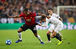 Manchester United's Antonio Valencia (left) and Valencia's Denis Cheryshev battle for the ball