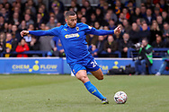 AFC Wimbledon defender Rod McDonald (26) passing the ball during the The FA Cup 5th round match between AFC Wimbledon and Millwall at the Cherry Red Records Stadium, Kingston, England on 16 February 2019.