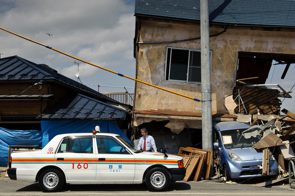 A taxi driver waiter for customers near the Ishinomaki Mangattan museum, Ishinomaki, Miyagi Prefecture, Japan, May 5, 2011. Almost two months after the devastating earthquake and tsunami the reconstruction has barely begun.