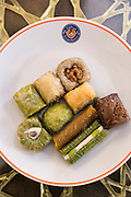 Plate of traditional Turkish honey covered sweetmeats, baklava, dessert of filo pastry and nuts, Istanbul, Turkey