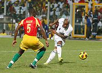Photo: Steve Bond/Richard Lane Photography.<br />Ghana v Guinea. Africa Cup of Nations. 20/01/2008. Bobo Balde (L) cannot get to Junior Agogo (R) before he shoots