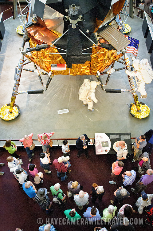 Visitors to the National Air and Space Museum listen to a guide explain the backup lunar landing module on display.