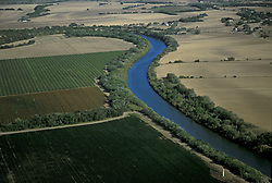 The Rio Grande River meanders through farmland in Texas.