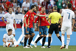 (l-r) Sergio Ramos of Spain, Sergio Busquets of Spain, referee Bjorn Kuipers during the 2018 FIFA World Cup Russia round of 16 match between Spain and Russia at the Luzhniki Stadium on July 01, 2018 in Moscow, Russia
