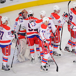 April 7, 2012: Washington Capitals players surround goalie Braden Holtby (70) following their 4-1 victory over the New York Rangers in NHL hockey action between the Washington Capitals and the New York Rangers at Madison Square Garden in New York, N.Y.