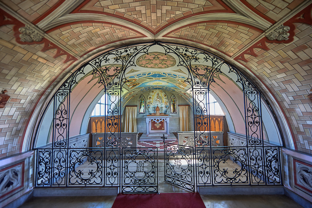 The Italian Chapel constructed of 2 nissen huts in 1942 at Italian prisoner of war Camp 60 next to Sapa Flow. The Italian inmates under the direction of their priests Father Giacobazziand Domenico Chiocchetti decorated the interior with Trompe-l'œil stonework and murals to resemble the interior of a Roman Catholic painted church. Lamb Holm, Orkney, Scotland .<br /> <br /> Visit our SCOTLAND HISTORIC PLACXES PHOTO COLLECTIONS for more photos to download or buy as wall art prints https://funkystock.photoshelter.com/gallery-collection/Images-of-Scotland-Scotish-Historic-Places-Pictures-Photos/C0000eJg00xiv_iQ