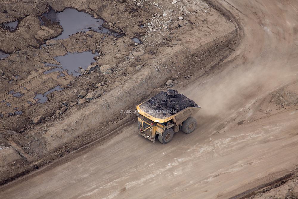 Haul truck carries tons of mined earth, Suncor Millenium Mine, Alberta