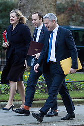 London, UK. 8th January, 2019. Amber Rudd MP, Secretary of State for Work and Pensions, Matt Hancock MP, Secretary of State for Health and Social Care, and Stephen Barclay MP, Secretary of State for Exiting the European Union, arrive at 10 Downing Street for the first Cabinet meeting since the Christmas recess.