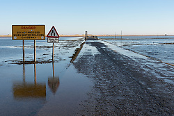 Tidal causeway road to Holy Island and Lindisfarne in  Northumberland , England, UK