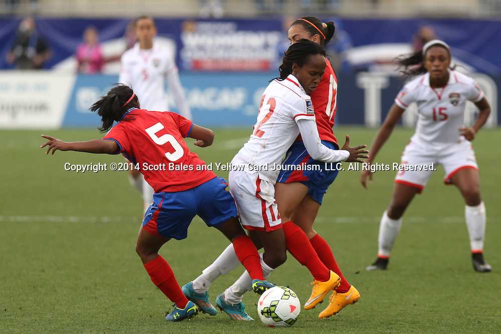 24 October 2014: Ahkeela Mollon (TRI) (12) is defended by Diana Saenz (CRC) (5) and Melissa Herrera (CRC) (17). The Costa Rica Women's National Team played the Trinidad & Tobago Women's National Team at PPL Park in Chester, Pennsylvania in a 2014 CONCACAF Women's Championship semifinal game, which serves as a qualifying tournament for the 2015 FIFA Women's World Cup in Canada. Costa Rica advanced to the championship game, and qualified for next year's Women's World Cup, by winning the penalty shootout 3-0 after the game ended in a 1-1 tie after double overtime.