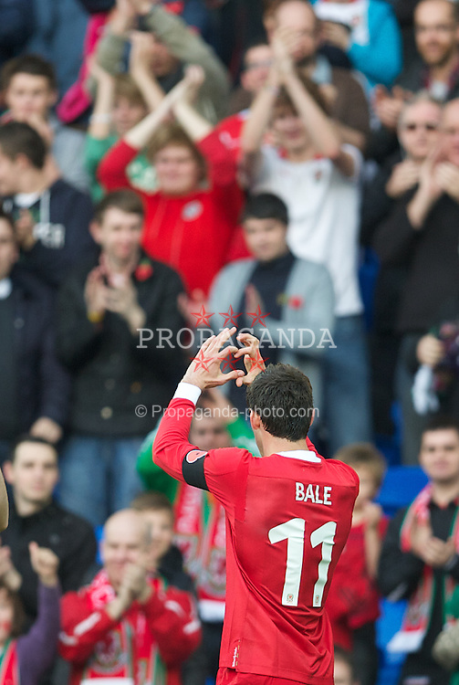 CARDIFF, WALES - Saturday, November 12, 2011: Wales' Gareth Bale celebrates scoring the first goal against Norway during the international friendly match at the Cardiff City Stadium. (Pic by David Rawcliffe/Propaganda)
