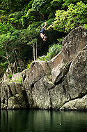 An adventurer doing a backflip into a river near Wulai, Taiwan.