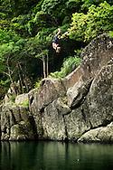 An adventurer doing a backflip into a river near Wulai, Taiwan.