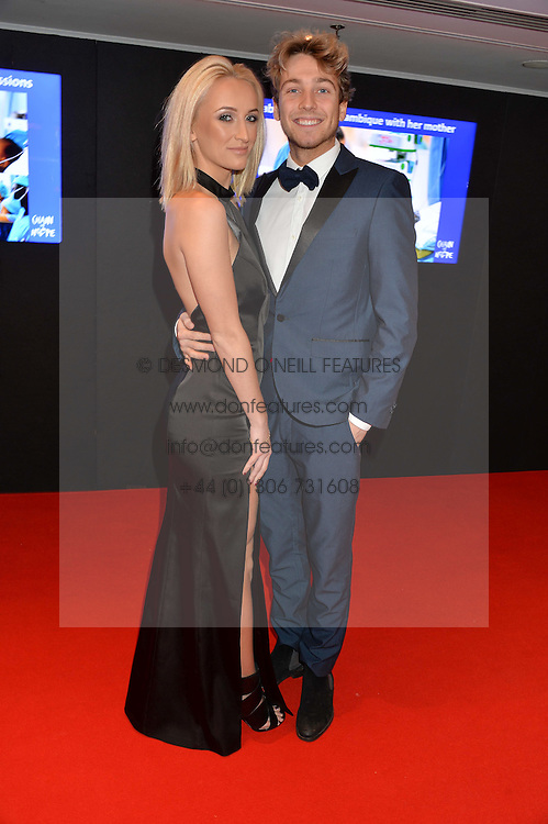 TIFFANY WATSON and SAM THOMPSON at the Chain of Hope Gala Ball held at The Grosvenor House Hotel, Park Lane, London on 18th November 2016.