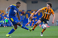AFC Wimbledon defender Darnell Johnson (27) clears the ball, Hull City midfielder George Honeyman (10) attacking during the EFL Sky Bet League 1 match between AFC Wimbledon and Hull City at Plough Lane, London, United Kingdom on 27 February 2021.