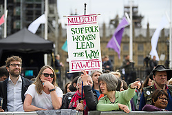 © Licensed to London News Pictures. 24/04/2018. London, UK. Members of the public hold a sign at the unveiling of a statue of Millicent Fawcett in Parliament Square, London. Dame Millicent, a leading Suffragist and campaigner for equal rights for women, is the first woman to be commemorated with a statue in Parliament Square. Photo credit: Ben Cawthra/LNP
