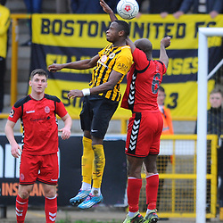 TELFORD COPYRIGHT MIKE SHERIDAN 2/3/2019 - HANDBALL. Theo Streete of AFC Telford leads with his arm in an aerial battle with Jonathan Wafula and gives away a penalty during the National League North fixture between Boston United and AFC Telford United at the York Street Jakemans Stadium