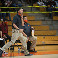 Gallup Bengals head coach Joshua Dunlap yells from the bench in the second quarter against Grants Tuesday night at Gallup High School in Gallup.