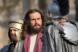 Trafalgar Square, London, March 25th 2016. Thousands of Londoners an tourists in Trafalgar Square are treated to The Passion of Jesus, a re-enactment of the events leading up to the crucifixion and resurrection of Jesus Christ. PICTURED: Jesus is tried. <br /> ©Paul Davey<br /> FOR LICENCING CONTACT: Paul Davey +44 (0) 7966 016 296 paul@pauldaveycreative.co.uk