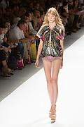 Short shorts with lace hem and trim details and a sequined jacket. By Custo Barcelona at the Spring 2013 Fashion Week show in New York.