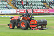 A groundsman out with the verti-drainer punching holes in the wet outfield as rain delays play during the Specsavers County Champ Div 1 match between Somerset County Cricket Club and Essex County Cricket Club at the Cooper Associates County Ground, Taunton, United Kingdom on 25 September 2019.