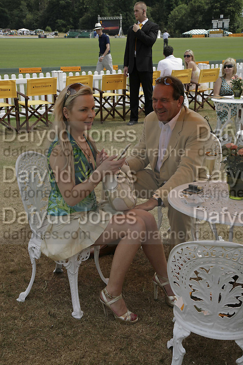 Rasa Stromskiene and John Ormiston, Veuve Clicquot Gold Cup 2006. Final day. 23 July 2006. ONE TIME USE ONLY - DO NOT ARCHIVE  © Copyright Photograph by Dafydd Jones 66 Stockwell Park Rd. London SW9 0DA Tel 020 7733 0108 www.dafjones.com