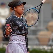 PARIS, FRANCE May 28. Naomi Osaka of Japan juggles her racquet during her match against Anna Karoline Schmljanovic of Slovakia on Court Philippe-Chatrier in the Women's Singles first round match at the 2019 French Open Tennis Tournament at Roland Garros on May 28th 2019 in Paris, France. (Photo by Tim Clayton/Corbis via Getty Images)