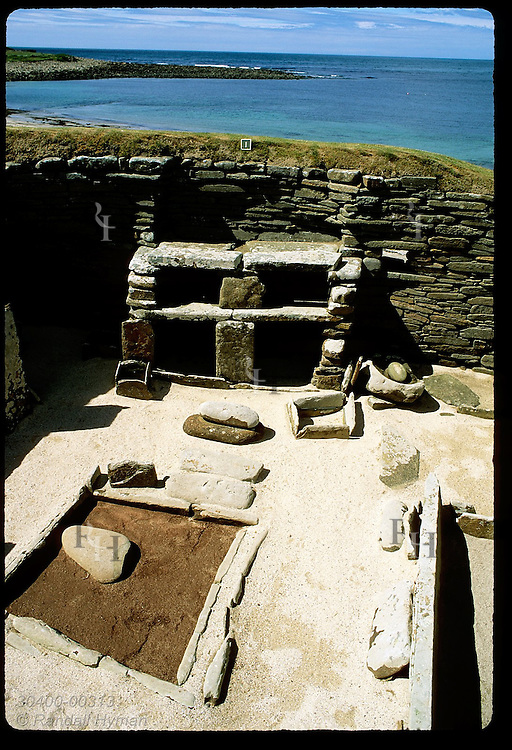 Restored double hearth is showcased in 5000-yr-old home at Skara Brae settlement; Orkney Islands. Scotland