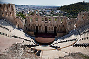The Odeon of Herodes Atticus is a stone theatre structure located on the south slope of the Acropolis of Athens. It was built in 161 AD by Herodes Atticus in memory of his wife, Aspasia Annia Regilla. It was originally a steep-sloped amphitheater with a three-story stone front wall and a wooden roof, and was used as a venue for music concerts with a capacity of 5,000. Athens is the capital and largest city of Greece. It dominates the Attica periphery and is one of the world's oldest cities, as its recorded history spans around 3,400 years. Classical Athens was a powerful city-state. A centre for the arts, learning and philosophy.